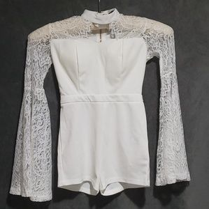 White romper. Tried on once. Perfect condition!